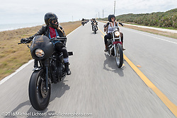 Iron Lillies Leticia Cline (L) and Kissa Von Addams Riding Highway A1A along the coast during Daytona Bike Week 75th Anniversary event. FL, USA. Thursday March 3, 2016.  Photography ©2016 Michael Lichter.