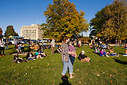 12 OCTOBER 2020 - DES MOINES, IOWA: People sit on the south lawn of the Iowa State Capitol. About 150 people attended the Indigenous Peoples Day 2020 observance at the Iowa State Capitol. They protested the theft and colonization of indigenous lands and the presence of a bust honoring Christopher Columbus on the capitol grounds.    PHOTO BY JACK KURTZ