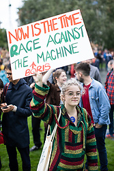 © Licensed to London News Pictures. 31/08/2019. Manchester, UK. A woman lifts up a placard reading Now is the time rage against the Boris Machine . Thousands attend a pro EU demo in Cathedral Gardens in Manchester City Centre , with objections raised to the Prime Minister Boris Johnson's intention to prorogue Parliament in the run up to Britain's planned Brexit deadline . Photo credit: Joel Goodman/LNP
