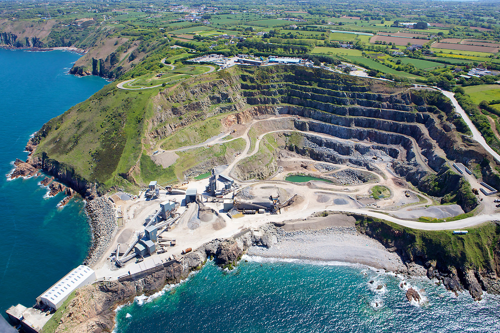 Aerial view of the granite quarry on the coastline of Jersey, Channel Islands, on a sunny summer day.