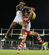 Jude Bolton of the Swans and Aaron Hall of the Suns go up for a mark during the 2013 NAB Cup round 03 match between the Sydney Swans and the Gold Coast Suns at Blacktown International Sportspark, Sydney. (Photo: Craig Golding/AFL Media)