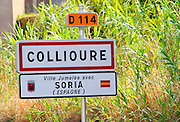 D114, Collioure city limit sign. Sister city with Soria in Spain. Collioure. Roussillon. France. Europe.