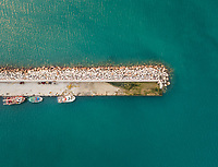 Aerial view of small fishing boats tied to dock in Patras, Greece