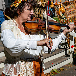 Lancaster, PA, USA - October 9, 2016: A violinist plays her fiddle during the Harvest Day celebration at the Landis Valley Farm Museum.