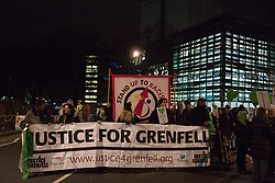 London, UK. 14th January, 2019. Members of the Grenfell community set off from beneath the Grenfell Tower on the Grenfell Silent Walk around North Kensington on the monthly anniversary of the fire on 14th June 2017. 72 people died in the Grenfell Tower fire and over 70 were injured.