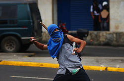 Anti-chavez protestors launch marbles, molotov cocktails and rocks at National Guard members during clashes between the two groups.  The clashes broke out during a Pro-Chavez march denouncing a recall referendum against chavez and US intervention in Venezuela.