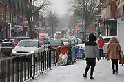 Traffic and people struggle in freezing weather, dubbed 'The Beast from the East' due to the sub zero cold temperature winds coming in from Siberia, descends on Kings Heath High Street on 1st March 2018 in Birmingham, United Kingdom.