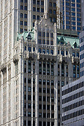 Modern architecture and the 1903 Gothic Woolworth building on the left, in Manhattan, New York City. High-rise buildings are mostly corporate offices though some apartments in this, one of the world's great megacities. They occupy addresses along Broadway - a mixture of modernity and 19th century architecture can be seen in detail.
