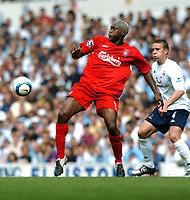 Djibril Cisse <br />Liverpool 2004/05<br />Sean Davis Tottenham Hotspur<br />Tottenham Hotspur v Liverpool (1-1) 14/08/04<br />The Premier League<br />Photo Robin Parker Fotosports International