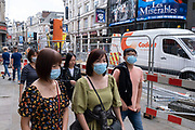 Even though most restrictions have come to an end, and the West End is busier than much of the last 18 months as people return to work, for shopping or sightseeing, many people are still wearing face masks especially in busy areas on 10th August 2021 in London, United Kingdom. Many people are wearing face masks in crowded places like this but they are no longer mandatory, while government advice suggests that it is advised to wear a face covering in busy public places inside and on transport, many people are still wearing them outside.