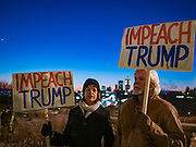 17 DECEMBER 2019 - DES MOINES, IOWA: Nancy Withers, left, and Mike Frakes at a rally calling for the impeachment of Donald Trump. About 300 people came to the Iowa State Capitol in Des Moines in near freezing weather to call for the impeachment of President Donald Trump. The rally, and others like it around the US, come on the eve of an impeachment vote in the US House of Representatives.          PHOTO BY JACK KURTZ