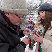 Toni McNamara and Denver Holt of the Owl Research Institute with a long-eared owl captured for data collection and soon to be released. Missoula, Montana