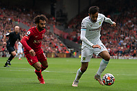 Football - 2021 / 2022 Premier League - Liverpool vs Burnley - Anfield - Saturday 21st August 2021<br /> <br /> <br /> Burnley's Dwight McNeil under pressure from Liverpool's Mohamed Salah