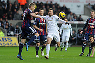 Swansea city's Michu © battles for the ball with Stoke's Ryan Shawcross. Barclays premier league, Swansea city v Stoke city at the Liberty Stadium in Swansea on Saturday 19th Jan 2013. pic by Andrew Orchard, Andrew Orchard sports photography,