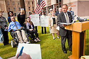 06 FEBRUARY 2012 - PHOENIX, AZ:   A reporter takes notes while Arizona State Senator STEVE GALLARDO, a Democrat, explains his opposition to a state bill that would allow concealed weapons on college campuses on Monday, Feb. 6. The Arizona State Senate's Judiciary Committee, chaired by Sen Ron Gould (Republican) debated several bills Monday that would loosen the state's gun laws, already among the loosest in the United States. One bill would allow anyone with a concealed carry permit to carry guns on the grounds of public universities. Universities could only ban guns if they provided secured gun lock boxes in each building. Universities, which are opposed to the legislation, say that the lock boxes would cost hundreds of thousands of dollars and that guns would make the campuses less safe. Most of the police departments in Arizona, as well as university student bodies, also oppose the legislation to allow guns on campus. PHOTO BY JACK KURTZ