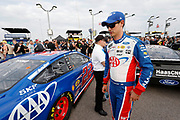 Joey Logano waits for the start of a NASCAR Cup Series auto race at Kansas Speedway in Kansas City, Kan., Saturday, May 12, 2018. (AP Photo/Colin E. Braley)