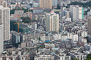 Buildings stand in Huizhou, Guangdong province, China, on Monday, April 18, 2016. Once synonymous with Chinas manufacturing might, as the days of cheap land and labor recede, the provinces businesses are in a race to upgrade or move.