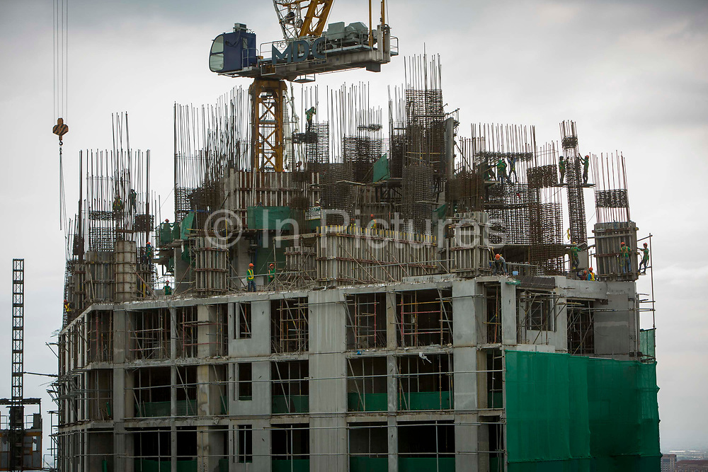 MDC construction workers during the day on top on Garden Towers under construction in Makati, Metro Manila, Philippines.