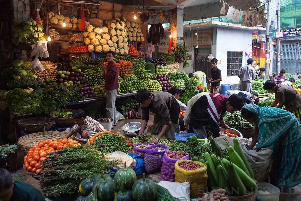 A farmer's market in Dhaka, Bangladesh with an abundance of fresh produce.
