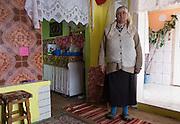 A Roma woman standing in the family home in the all-Roma farming village of Unguraia in Cristesti Community, Botosani County, Romania.