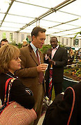 Mr. and Mrs. Richard E. Grant and Linford Christie, Chelsea Flower Show. 19 May 2003. © Copyright Photograph by Dafydd Jones 66 Stockwell Park Rd. London SW9 0DA Tel 020 7733 0108 www.dafjones.com