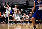 Aspen boys varsity basketball team react after Jack Seamans scored on Cedaredge during the playoff game at Aspen High School in Aspen, Colorado.