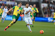 Alberto Paloschi of Swansea city ® goes past Ryan Bennett of Norwich city. Barclays Premier league match, Swansea city v Norwich city at the Liberty Stadium in Swansea, South Wales  on Saturday 5th March 2016.<br /> pic by  Andrew Orchard, Andrew Orchard sports photography.