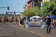 30 JUNE 2012 - PRESCOTT, AZ:   The Prescott Frontier Days Rodeo Parade marches through downtown Prescott. The parade is marking its 125th year. It is one of the largest 4th of July Parades in Arizona. Prescott, about 100 miles north of Phoenix, was the first territorial capital of Arizona.   PHOTO BY JACK KURTZ