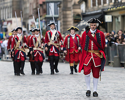 Edinburgh Riding of the Marches commemorates the return in 1513 of Randolph Murray clasping the Ancient Blue Blanket Banner with the tragic news of the defeat of the Scottish Army at the Battle of Flodden. 280 Horses traverse the boundaries of Edinburgh before culminating in a procession along the Royal Mile culminating in a ceremony celebrating the return of the flag at the historic Mercat Cross.<br /> <br /> Pictured: Members of the Edinburgh City Guard