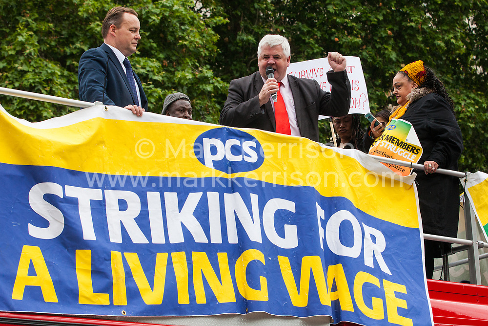 London, UK. 19 June, 2019. Hugh Gaffney, Scottish Labour Party MP for Coatbridge, Chryston and Bellshill, addresses outsourced catering, security, postal, porter and cleaning staff belonging to the Public & Commercial Services Union (PCS) and working at the Department for Business, Energy and Industrial Strategy (BEIS) via contractors ISS World and Aramark at a rally outside Parliament on the third day of continuing industrial action for the London Living Wage, terms and conditions comparable to the civil servants they work alongside and an end to outsourcing.