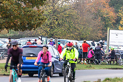 © Licensed to London News Pictures. 08/11/2020. London, UK. Members of the public go out to exercise in a busy Richmond Park in South West London on the 4th day of the new lockdown. Cyclists, walkers, and families descended on the park and picnic tables as traffic jams built up at car parks while Police patrolled the park in 4x4 vehicles. Prime Minister Boris Johnson announced new Covid-19 lockdown restrictions for England from last Thursday with pubs, restaurants, non-essential shops and gyms to close as the coronavirus infection rate continues to rise. Photo credit: Alex Lentati/LNP