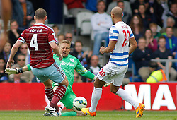 West Ham United's Kevin Nolan Queens Park Rangers' Robert Green and Queens Park Rangers' Richard Dunne compete for the ball - Photo mandatory by-line: Mitchell Gunn/JMP - Mobile: 07966 386802 - 25/04/2015 - SPORT - Football - London - Loftus Road<br />  - QPR v West Ham United - Barclays Premier League