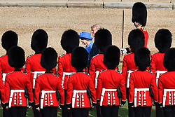 """Britain's Queen Elizabeth II (L) and US President Donald Trump (R) inspect the guard of honour formed of the Coldstream Guards during a welcome ceremony at Windsor Castle in Windsor, west of London, on July 13, 2018 on the second day of Trump's UK visit.<br /> US President Donald Trump launched an extraordinary attack on Prime Minister Theresa May's Brexit strategy, plunging the transatlantic """"special relationship"""" to a new low as they prepared to meet Friday on the second day of his tumultuous trip to Britain. / AFP PHOTO / POOL / Ben STANSALL"""