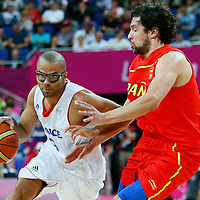 08 August 2012: France Tony Parker drives past Sergio Llull during 66-59 Team Spain victory over Team France, during the men's basketball quarter-finals, at the 02 Arena, in London, Great Britain.
