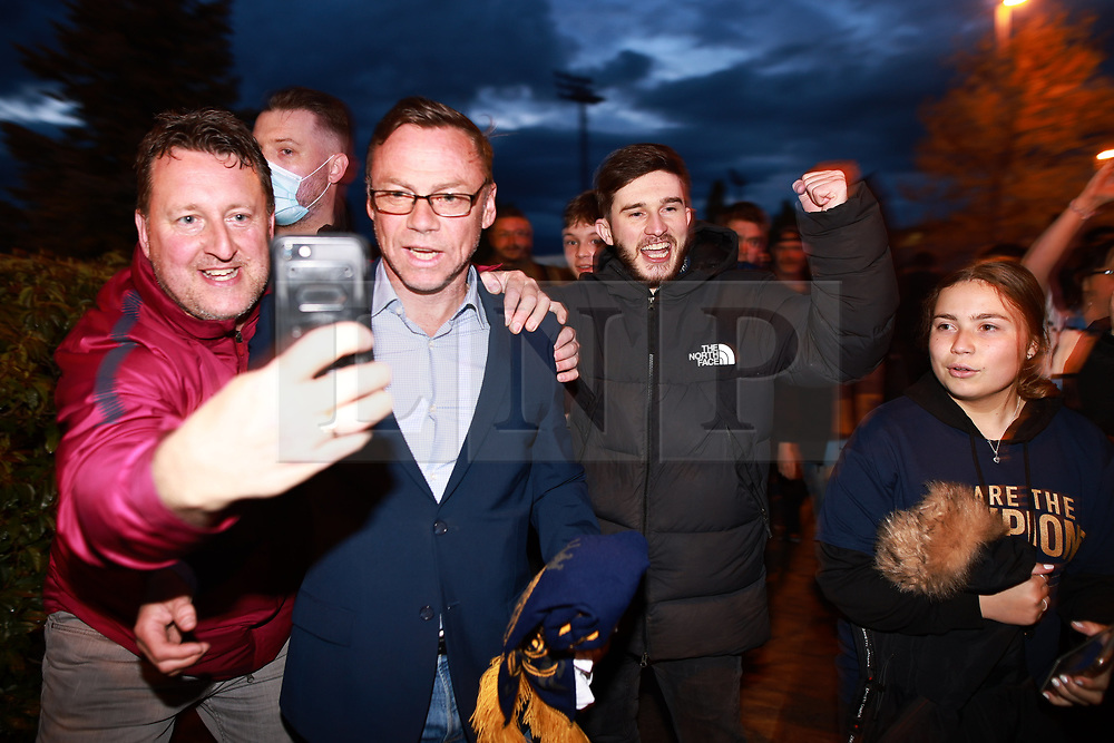 © Licensed to London News Pictures. 11/05/2021. Manchester, UK. PAUL DICKOV with fans. Manchester City fans celebrate outside the Etihad Stadium after their team wins the Premiership following Manchester United's loss at home to Leicester City this evening (11th May 2021). Photo credit: Joel Goodman/LNP