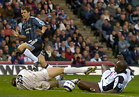 Photo: Glyn Thomas.<br />West Bromwich Albion. Newcastle Utd. The Barclays Premiership. 30/10/2005.<br /> Newcastle's Michael Owen (L) tries to send the ball between Tomasz Kuszczak (C) and Darren Moore (R).