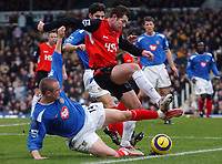 Photo. Daniel Hambury.<br /> Portsmouth v Blackburn Rovers. 15/1/2005.<br /> Barclays Premiership.<br /> Portsmouth's Matthew Taylor forces Blackburn's Brett Emeron wide.