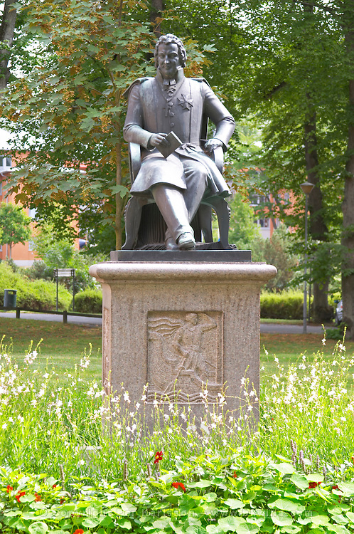 A statue of Esaias Tegnér Tegner in the cathedral park. In the Linné Linne Linnaeus park. Vaxjo town. Smaland region. Sweden, Europe.