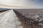 Road cut through Salar de Atacama, Atacama Desert, Chile, South America