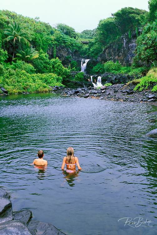 Kids enjoying a swim at Ohea'o Gulch (the Seven Sacred Pools), Haleakala National Park, Maui, Hawaii