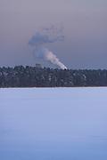 Dusky coast and forests along lake Sloka with water tower and some smoke from nearby town, Kemeri National Park (Ķemeru Nacionālais parks), Latvia Ⓒ Davis Ulands   davisulands.com