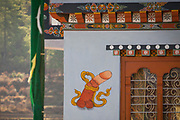 Phallic symbol painted on the side of a house in Bhutan to ward off evil spirits and bring good luck
