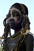 Young Boy wearing head gear, Mursi Tribe, Mago National Park, Lower Omo Valley, Ethiopia, portrait, person, one, tribes, tribal, indigenous, peoples, Southern, ethnic, rural, local, traditional, culture, primitive,