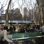 Men play a game of table tennis in Bryant Park, Manhattan, New York, USA. Photo Tim Clayton