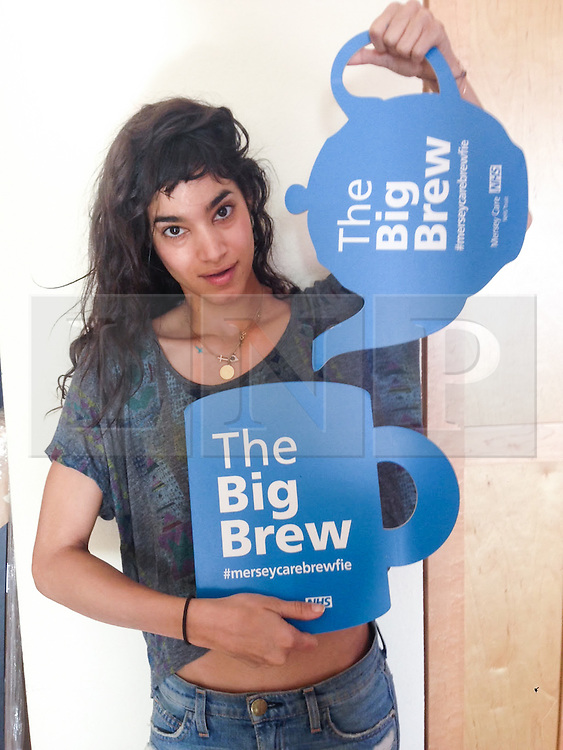 """© Licensed to London News Pictures . 19/01/2015 . Liverpool , UK . Dancer and actress Sofia Boutella . Celebrities pose with """" Big Brew """" placards in support of mental health awareness as today (19th January 2015) marks """" Blue Monday """" , the day regarded by many as the most depressing in the year . Campaigners are urging the public to show support by tweeting sefies with their favourite brew and the hashtag """" #brewfie """" . In London , Deputy Prime Minister Nick Clegg , is announcing his campaign to improve mental health awareness , reduce stigma and promote a """" zero ambition """" target for suicide . Photo credit : Joel Goodman/LNP"""