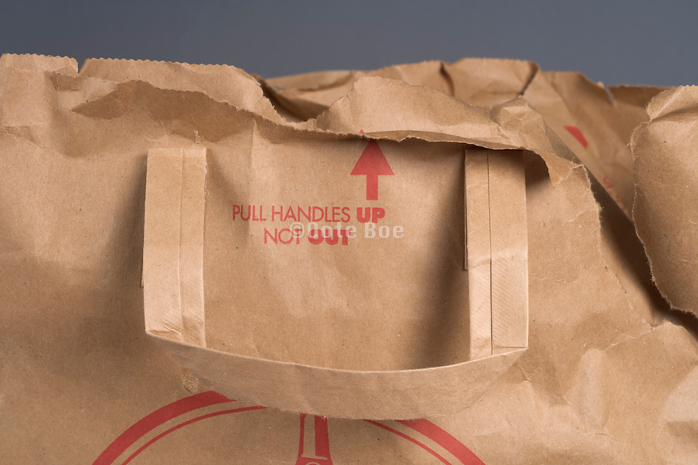 handle of a brown paper shopping bag
