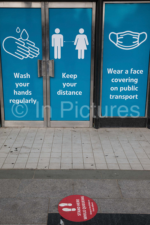 COVID-19 post lockdown public information posters displayed in shop doors on 21st August 2020 in Slough, United Kingdom. Slough has been listed by Public Health England PHE and the Department for Health and Social Care DHSC as an 'area of concern' for COVID-19 following a rise in positive coronavirus cases over the last two weeks.