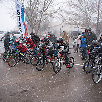 Snow falls as kids participate in the Quad Kids race on Hill Street at the start line of the Mt. Taylor Winter Quadrathlon, Saturday, Feb. 16 in Grants.
