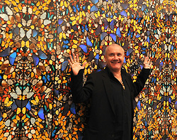 © Licensed to London News Pictures. 02/04/2012. London, UK Damine Hirst stands with 'Doorways to the Kingdom of Heaven' . The Tate Modern presents the first substantial retrospective of British artist Damien Hirst. The exhibition runs 4th April - 9th September at Tate Modern London. Photographers Stephen Simpson/LNP