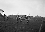 Brophy, in possession, makes a dash for the line with two English backs about to pursue,..Irish Rugby Football Union, Ireland v England, Five Nations, Landsdowne Road, Dublin, Ireland, Saturday 9th February, 1963,.9.2.1963, 2.9.1963,..Referee- H B Laidlaw, Scottish Rugby Union, ..Score- Ireland 0 - 0 England, ..Irish Team, ..B D E Marshall, Wearing number 15 Irish jersey, Full Back, Queens University Rugby Football Club, Belfast, Northern Ireland,..W R Hunter, Wearing number 14 Irish jersey, Right Wing, C I Y M S Rugby Football Club, Belfast, Northern Ireland, ..J C Walsh,  Wearing number 13 Irish jersey, Right Centre, University college Cork Football Club, Cork, Ireland,..P J Casey, Wearing number 12 Irish jersey, Left Centre, University College Dublin Rugby Football Club, Dublin, Ireland, ..N H Brophy, Wearing number 11 Irish jersey, Left wing, Blackrock College Rugby Football Club, Dublin, Ireland, ..M A English, Wearing number 10 Irish jersey, Stand Off, Landsdowne Rugby Football Club, Dublin, Ireland, ..J C Kelly, Wearing number 9 Irish jersey, Scrum Half, University College Dublin Rugby Football Club, Dublin, Ireland,..R J McLoughlin, Wearing number 1 Irish jersey, Forward, Blackrock College Rugby Football Club, Dublin, Ireland, ..A R Dawson, Wearing number 2 Irish jersey, Forward, Wanderers Rugby Football Club, Dublin, Ireland, ..S Millar, Wearing number 3 Irish jersey, Forward, Ballymena Rugby Football Club, Antrim, Northern Ireland,..W A Mulcahy, Wearing number 5 Irish jersey, Captain of the Irish team, Forward, Bective Rangers Rugby Football Club, Dublin, Ireland,  ..W J McBride, Wearing number 5 Irish jersey, Forward, Ballymena Rugby Football Club, Antrim, Northern Ireland,..E P McGuire, Wearing number 6 Irish jersey, Forward, University college Galway Football Club, Galway, Ireland,..C J Dick, Wearing number 8 Irish jersey, Forward, Ballymena Rugby Football Club, Antrim, Northern Ireland,..M D Kiely, Wearing number 7 Irish jersey, Forward, Landsdowne Rug